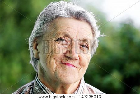 Happy granny face on a green background
