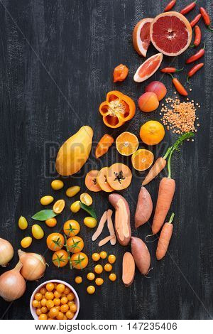 Color spectrum of vibrant raw produce fruit and vegetables from yellow orange to red