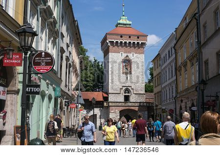 POLAND, KRAKOW - MAY 27, 2016: Krakow is the second largest and one of the oldest cities in Poland. Medieval tower of the Florian Gate in Krakow, Poland.