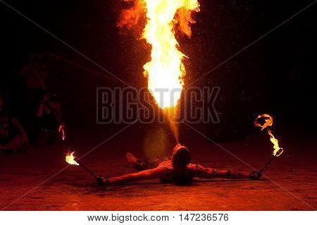 RUSSIA, BALTIYSK - JULY 06, 2014: The unknown artists demonstrate the fire show at the open festival BALTIC FIRE FEST - 2014 on july 06, 2014 in Baltiysk, Kaliningrad region.