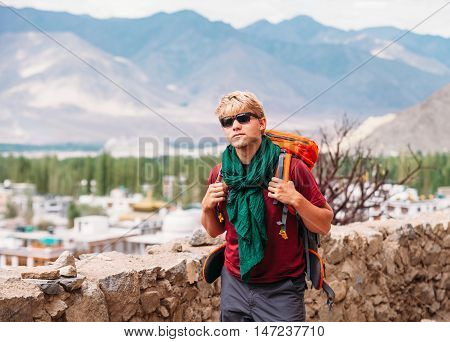 Backpacker tourist in tibetan settlement in Himalaya