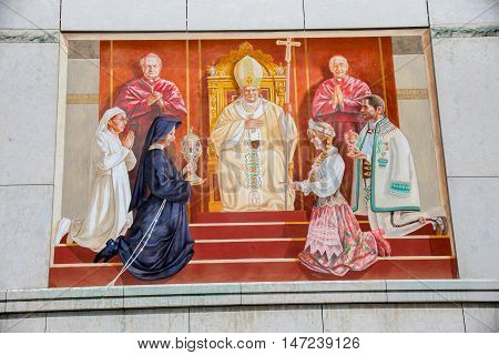 POLAND, KRAKOW - MAY 28, 2016: Sanctuary in Lagiewniki. Mural on the wall of the centre of Pope John Paul II. Millions of pilgrims from around the world visit it every year.