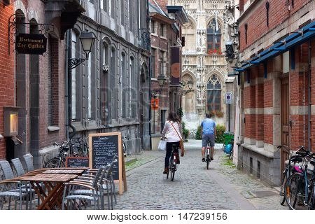 BELGIUM, LEUVEN - SEPTEMBER 04, 2014: The narrow street in the historic Leuven. Leuven is the capital of the province of Flemish Brabant in Belgium.
