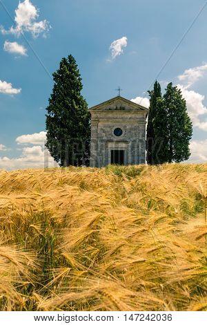 Church in Val d'Orcia Tuscany Italy. Cappella di Vitaleta chapel found near San Quirico d'Orcia.
