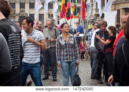 BELGIUM, BRUSSELS - SEPTEMBER 07, 2014: Belgian Beer Weekend 2014. The most famous beer festival in Belgium. Happy woman at the festiwal.