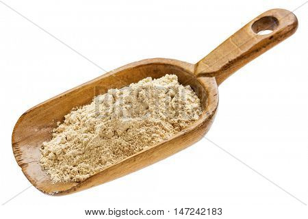 maca root powder on  a rustic wooden scoop isolated on white