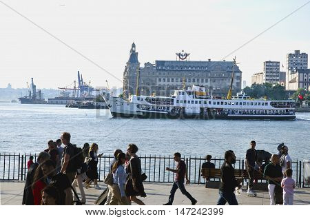 Istanbul Turkey - May 29 2016: The centre of Kadikoy today is the transportation hub for people commuting between the Asian side of the city and the European side across the Bosphorus. There is a large bus and minibus terminal next to the ferry docks. Fer