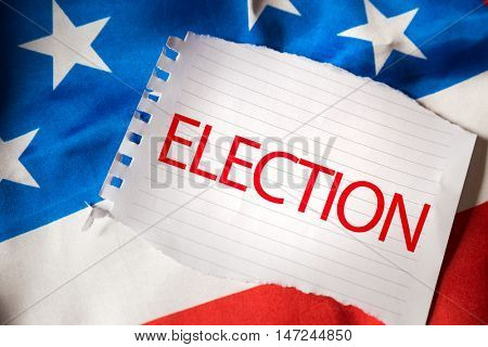 Election on notepaper and the US flag