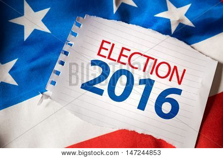 Election 2016 on notepaper and the US flag