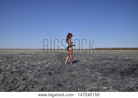 Girl Standing On The Dry Bottom Of A Salt Lake