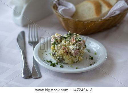 Meat salad with mayonnaise on a plate closeup. Food