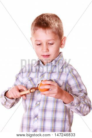 Nature and free time prankster little boy. Child have fun with wooden sling shot and fruit hold orange.