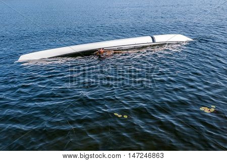 man sculling with a kayak on a lake - serial pictures