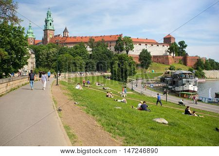 POLAND, KRAKOW - MAY 27, 2016: View of the Wawel Hill with the famous medieval castle with Sigismund Tower, Clock Tower, and Silver Bell Tower. Near Vistula river.