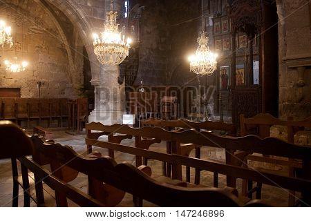 CYPRUS, KYRENIA - NOVEMBER 12, 2013: The interior of the old Greek Orthodox church in Bellapais Abbey in Northern Cyprus in Kyrenia (Girne).