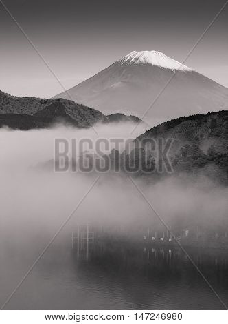 Mt. Fuji and Ashi lake with mist in autumn morning, black and white