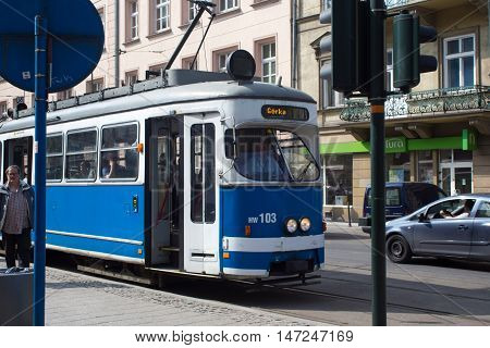 POLAND, KRAKOW - MAY 27, 2016: Tram SGP/Lohner E1 in the historic part of Krakow. Total in Krakow more than 90 kilometers of tram tracks and 24 routes.