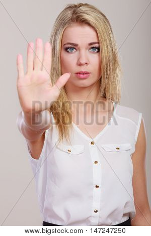 Woman saying stop. Girl showing denial hand sign gesture.