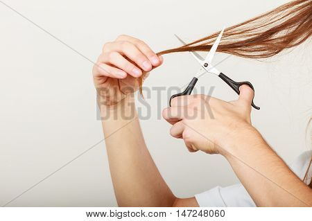 Male Hands Cutting Long Hair