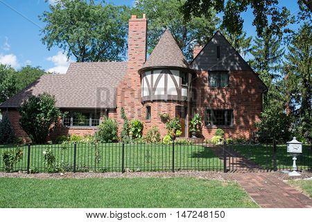Red Brick English Tudor House with Round Turret