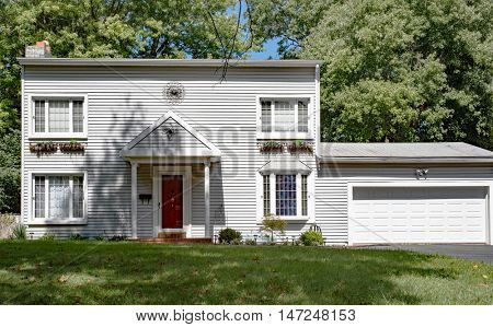 Plain White House with Red Door