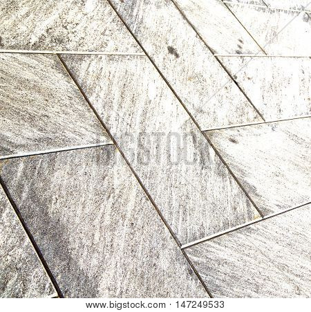 Near Mozzate Street  Pavement Of A Curch And Wall Marble