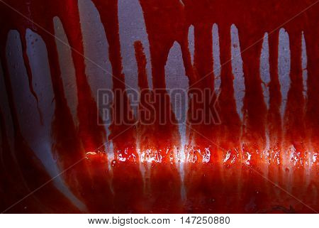A closeup view of a bloody mess in a kitchen sink.