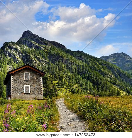 old shelter in in mountains landscape near Rhemes Notre Dame
