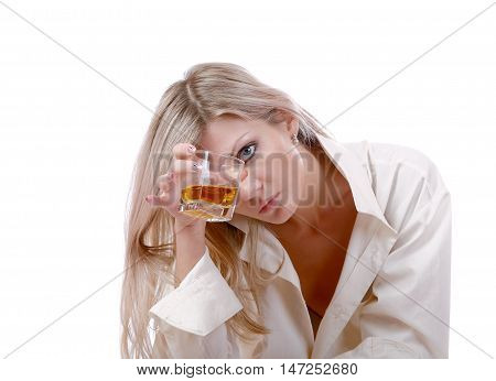 The girl with glass of whisky on a white background