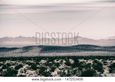 Mountains and hills in the dry desert covered with dry grass near Death Valley Junction.