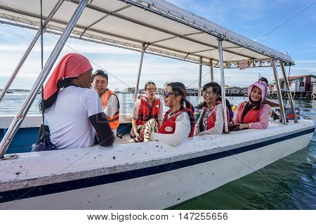 Semporna,Sabah-Sept 10,2016:Happy tourists on the speedboat at Semporna on 10th Sept 2016.Semporna is a gateway for diving & snorkeling trips to the islands of Sipadan,Mabul,Mataking,Maiga & others