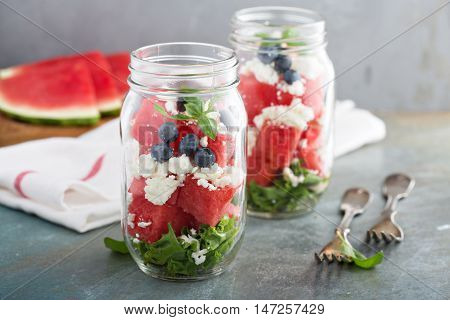 Watermelon salad in a jar with feta chees and mint