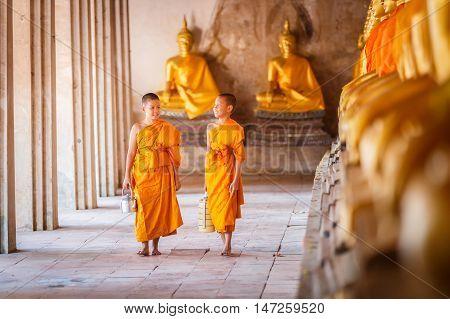 Novices at Ayutthaya Historical Park in Thailand