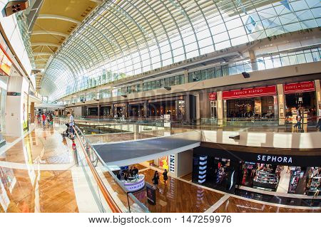 SINGAPORE - JUNE 6 2015 : The Shoppes at Marina Bay Sands is one of Singapore's largest luxury shopping malls with over 800000 square feet of high-end retail shoppes.