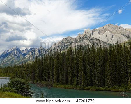 Canadian Landscape with Turquoise River and Rocky Mountains