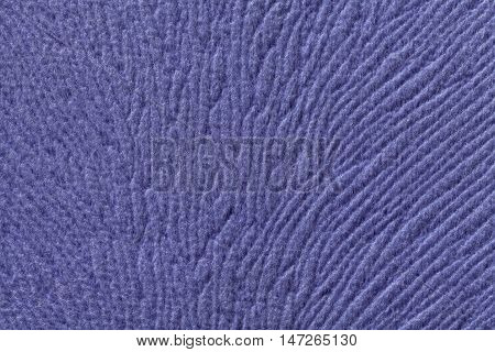 Violet background from a soft wool textile material closeup. Fabric with natural texture. Cloth backdrop.