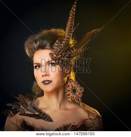 Girl harpy. Creative make-up for Halloween. Fantasy