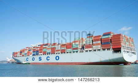 Oakland CA - September 13 2016: Cargo Ship COSCO EXCELLENCE departing the Port of Oakland the fifth busiest port in the United States.