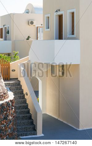 Beige modern outdoor concrete small stairway to house