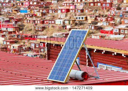 Solar panel on a red roof at Larung gar (Buddhist Academy) in Sichuan China