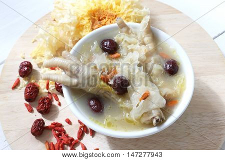 Chinese traditional snow fungus soup with chicken feet, red dates and goji