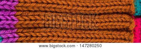 striped colorful wool texture handmade patten closeup macro  red green purple  brown