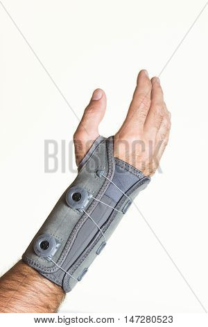 Bandage Wrist With Pressure Regulator On A Man's Hand - Isolate