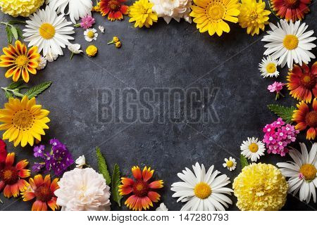 Garden flowers over stone table background. Backdrop with copy space