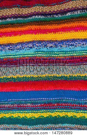 striped colorful wool texture handmade patten closeup macro blue red green yellow orange purple beige brown