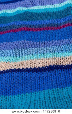 striped colorful wool texture handmade patten closeup macro blue red purple beige