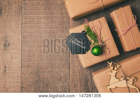 Christmas gifts on wooden background. Retro filter effect. View from above