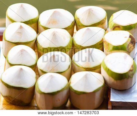 Fresh coconuts at Damnoen Saduak floating market in Ratchaburi near Bangkok Thailand