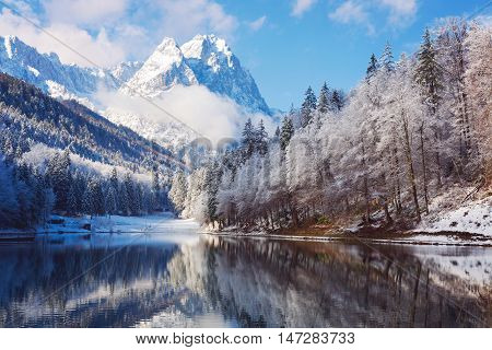 Nature winter landscape with lake over mountain and reflection