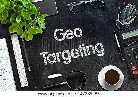 Geo Targeting - Text on Black Chalkboard.3d Rendering. Toned Image.